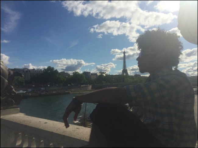 Peter Brack on the Pont Alexandre III with the Eiffel Tower in view (Photograph by Riley Brack)