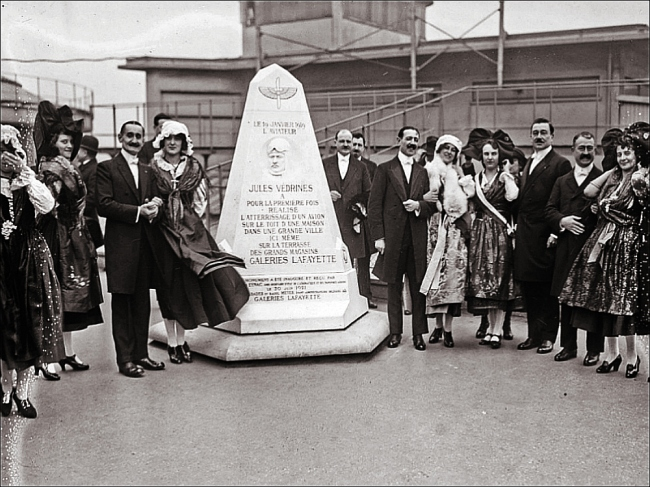 Strike up the band: In 1921 Galeries Lafayette celebrated Jules Védrines and his visionary contributions to aviation with a rooftop monument (Image: Bibliothèque nationale de France)