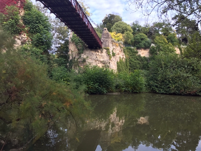 Reflecting on Pont Suspendu designed by Gustave Eiffel! Yes, it is a small world! (Photo by T. Brack)