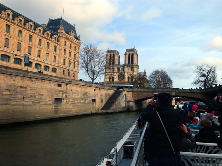 Paying tribute to Notre-Dame (Photo by Theadora Brack, River Boat Ride, March 2019)