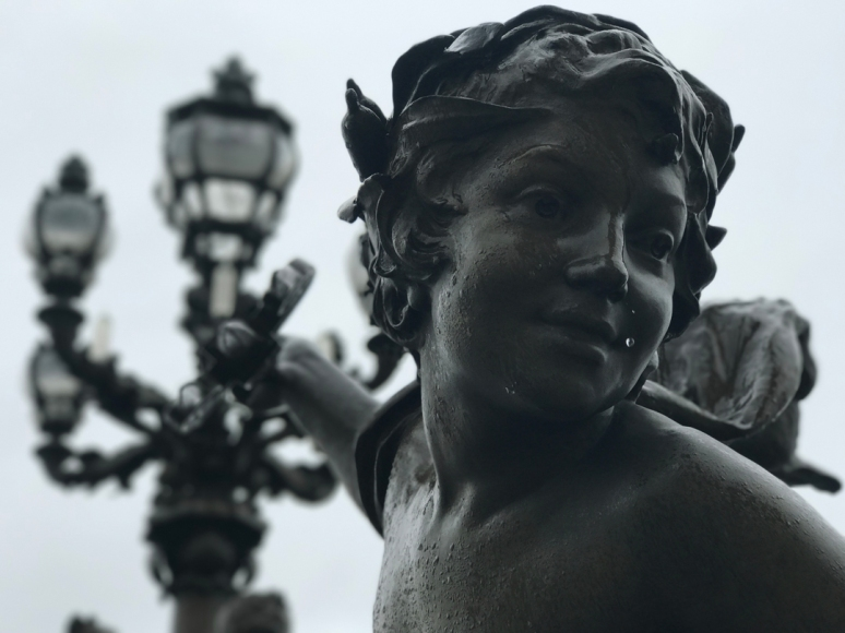 The weather in Paris can change at the drop of a Schiaparelli hat, so pack your camera and parapluie, Pont Alexandre III, Paris (Photo by Theadora Brack)