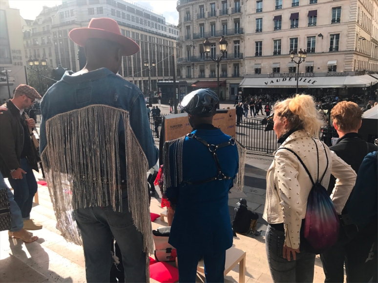 More inspiration for your OOTD mood board because, frankly, fringe with silver beaded detailing is always a great idea, post-show at the Palais Brongniart with the legendary Brasserie Vaudeville in view. (Photo by Theadora Brack)