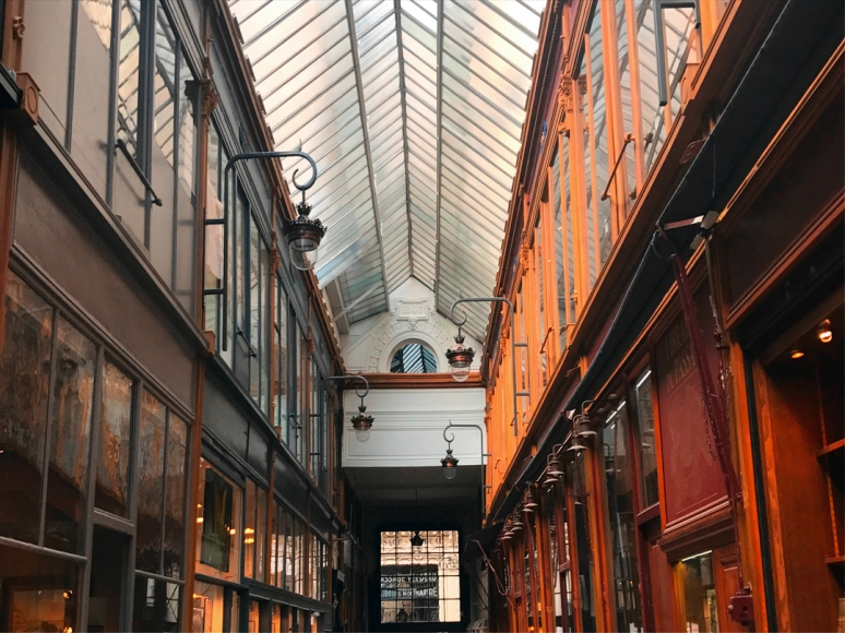 Passage Jouffroy with Passage Verdeau in view. More convenient shop-hopping? Yes. After all, moderation is always key when it comes to Paris. Says absolutely no one. And that goes double for the arcades. (Photo by Theadora Brack)