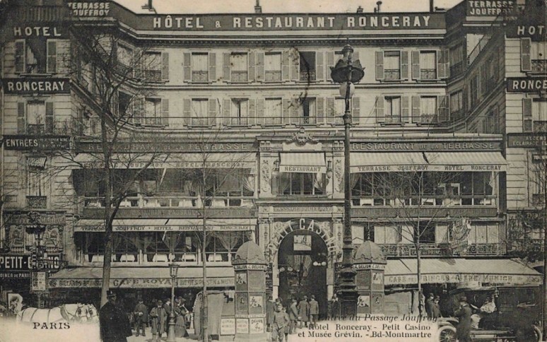 The early passages tempted shoppers with lux goodies and cafés in settings that were sheltered from rain, lighted with gas and (to some degree) heated. Passage Jouffroy in 1900. (Postcard, Theadora Brack's archives)