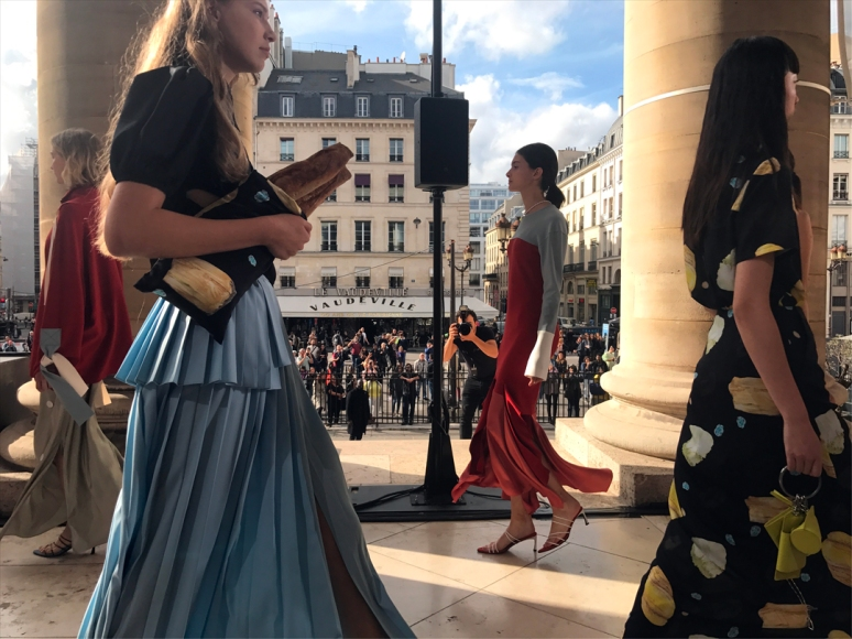 Now, on the K-Collection catwalk, I saw asymmetrical hems, frilly mock turtlenecks, long flowing, souped-up sleeves, ruffled multi-tiered skirts and tops, and cheese-patterned frocks. Baguettes in bags, too! (Photo by Theadora Brack)