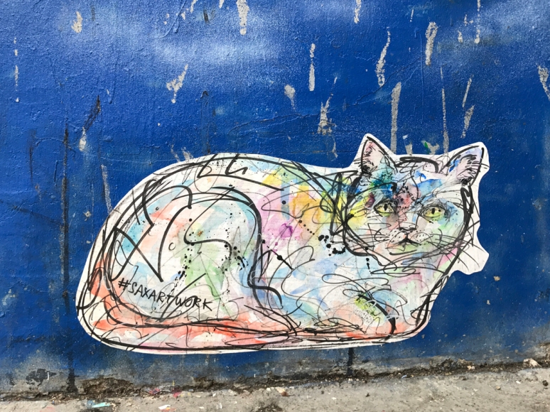 Hear me soar: Levitating cat by Henry Blache, @saxartwork, Abbesses (Photo by Theadora Brack)