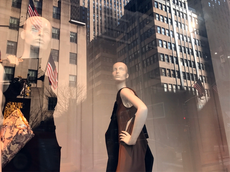 Saks, Study how the vitrines mesh with the reflections of the surrounding cityscape. Providing seamless backgrounds, the trees and skyscrapers play nicely with the mannequins. (Photo by Theadora Brack)